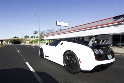 It is the most expensive modern car in the world at. beautiful white bugatti veyron vitesse rear side view in motion - SSsupersports