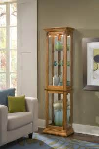 narrow curio cabinet in estate oak clearance by pulaski home gallery stores
