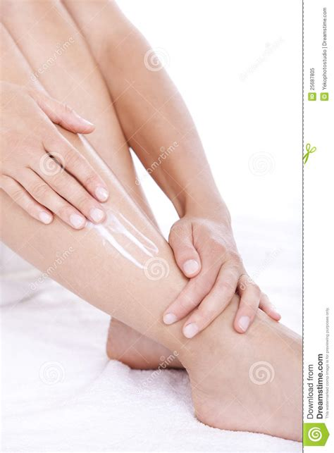 Woman Applying Moisturizer Cream On The Legs Royalty-Free