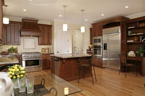 kitchen with cherry wood floors kitchen with cherry cabinets granite counter tops and red oak hardwood flooring kitchen