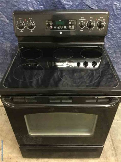 large images  black glass top stove  ge electric  cleaning  burner  year warranty