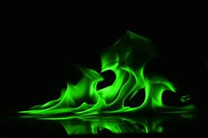 Abstract Green fire flames on black background Photo ...