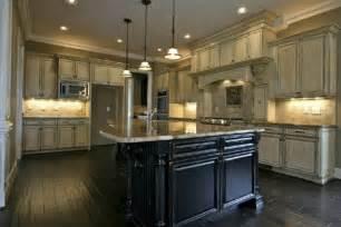 antique white kitchen island white kitchen cabinets with black island home design ideas