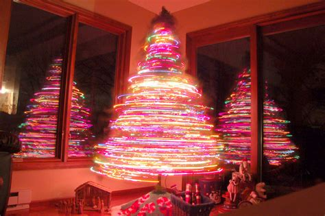 revolving christmas trees with lights rotating christmas tree 30 second exposure disco tree