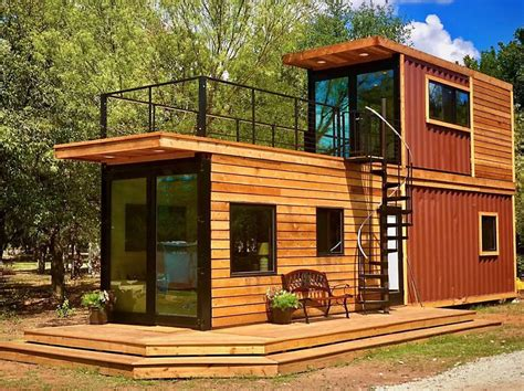 stacked  story shipping container home  roof terrace treehugger