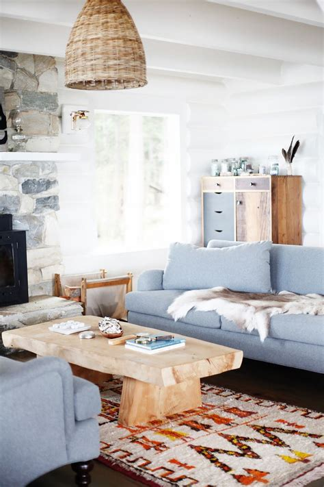 light blue couch living room inside a restored midcentury log cabin we all want to