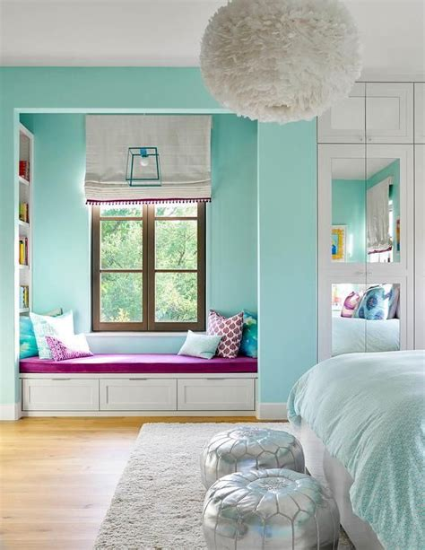 turquoise blue girls bedroom features  white feather