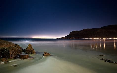 landscape beach rock reflection lights cape town