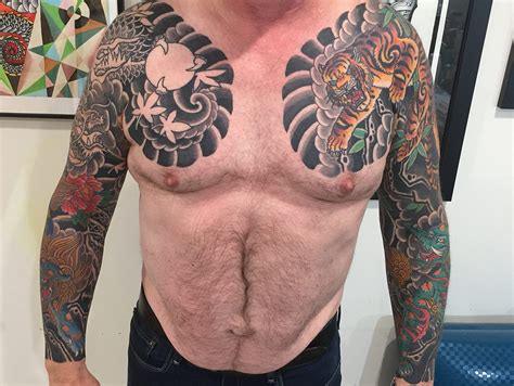 japanese sleeve tattoos  mike tiger dragon baku foo dog  joe haasch tattoo
