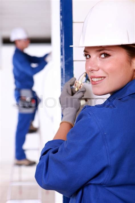 female electrician installing  power stock photo