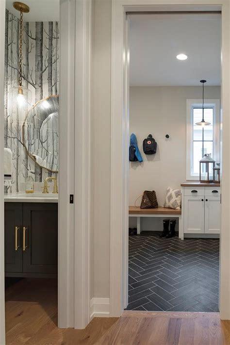 white mudroom bench  black herringbone tiles