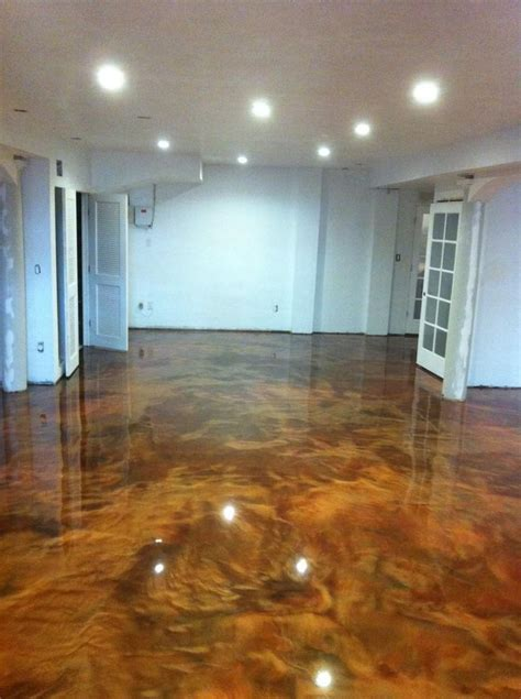 This basement floor receives a metallic epoxy coating w