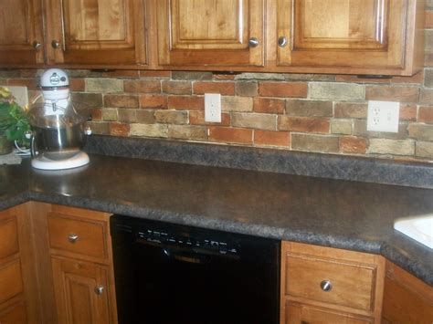 Painting Ideas For Kitchens - red brick backsplash for narrow kitchen design with oak wood cabinet and gray ceramic countertop