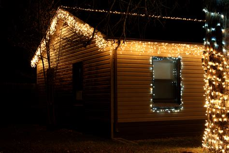 house with icicle lights picture free photograph