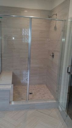 12 x 24 porcelain tile at shower wall with carrara hex at