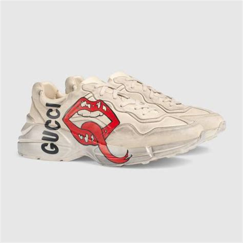 Gucci combines heritage classicism with modern elements as seen with the rhyton gucci logo leather sneakers. GUCCI RHYTON LIPS SHOES -sale   BLVCKS STREET CULTURE