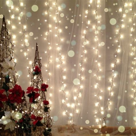 white backdrop with lights white lights and tulle for a soft christmas backdrop
