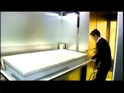 hong kong architect turns shoebox apartment   rooms