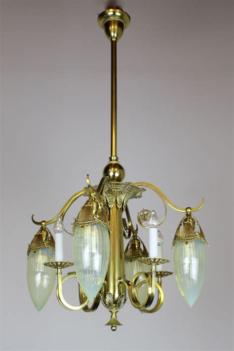 antique brass chandelier with painted glass shades