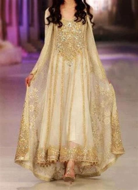 asian woman golden heavy embroidery long kameez pakistani