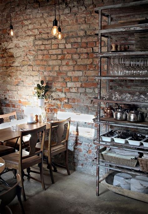 dining room with exposed brick wall nice industrial piece