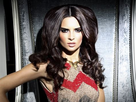 Glamorous hairstyle with long curls and a partition in the ...