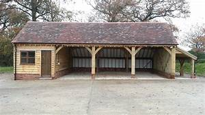 a classic 4bay garage with workshop and side log store With 4 bay pole barn