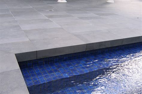 pool surround answers granite blue or sandstone