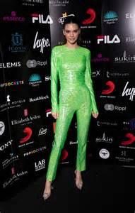 kendall jenner   neon green suit arrives   brit