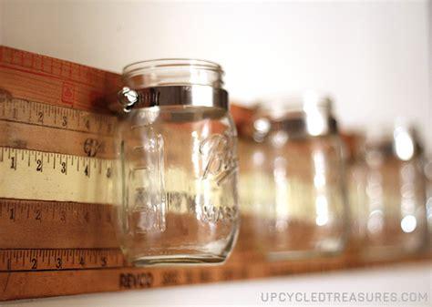 diy mason jar wall storage with vintage yardsticks