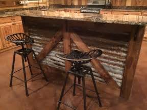 kitchen island with seats rustic kitchen island barn style island tractor seat bar stools our happy home