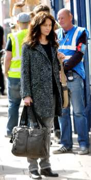 olga kurylenko goes without make up and dresses down for new role daily mail online