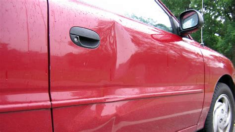 remove dent from car door remove minor dents from your car with a plunger