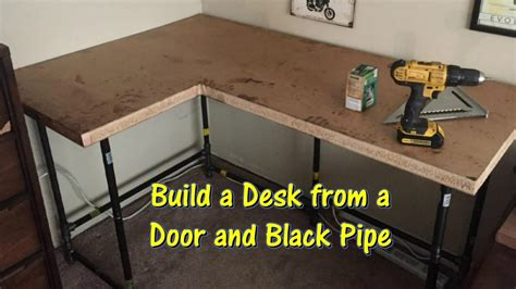 how to build a l build a desk using an old door and black pipe by