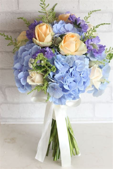 light blue hydrangea  peach roses wedding bouquet