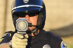 Cop w radar gun - Aragon Law Firm