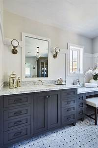 Bathroom with White Subway Tiles On Upper Walls and Board