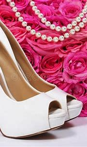 Bridal Shoes And Roses. White Heels Over Hot Pink Flowers ...