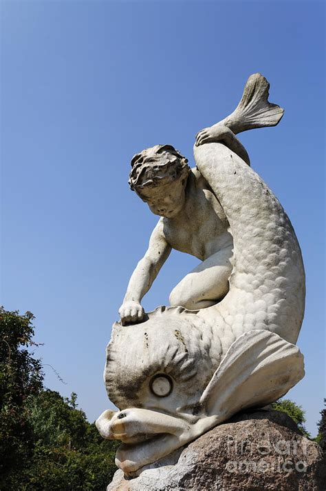 boy and dolphin sculpture by alexander munro in hyde park london england photograph by robert
