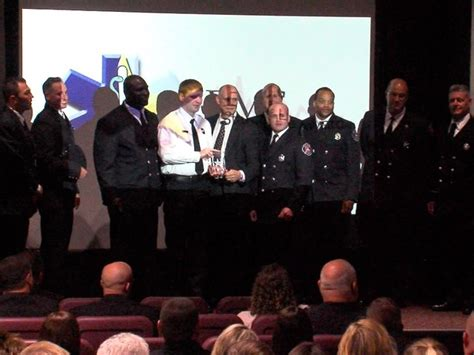 Akron firefighters honored for pulling man from burning