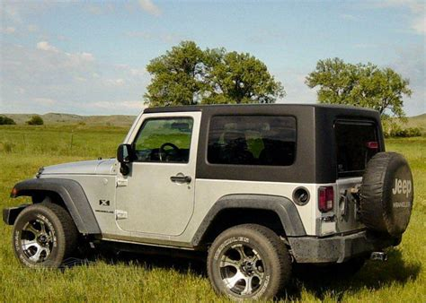 jeep wrangler 2 door soft top types of jeep wrangler tops how to care for them