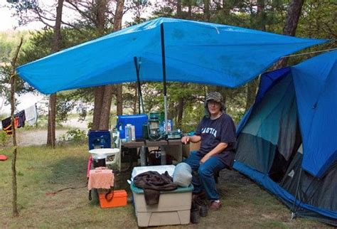 diy tent vestibule  tarp sticks poles diy tent camping vacations winter camping