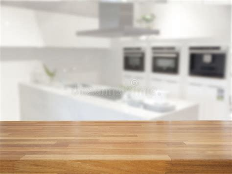 Empty Table And Blurred Kitchen Background Stock Photo