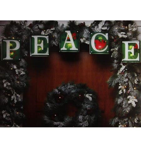 shimmering christmas lights 7 green shimmering quot peace quot light garland with 10 clear mini lights white wire