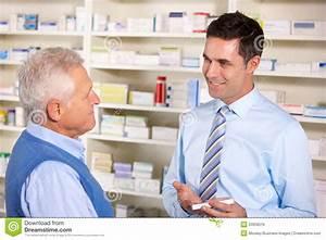 UK Pharmacist Serving Senior Man In Pharmacy Stock Image ...