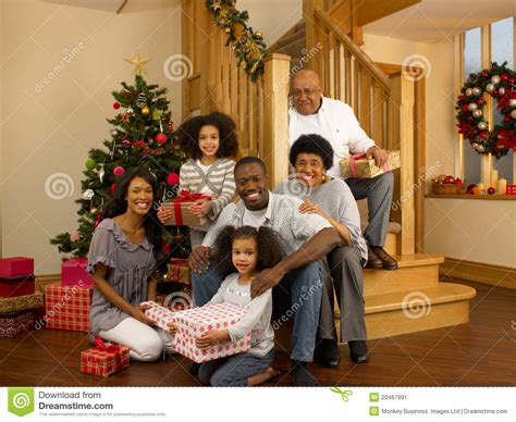 mixed race family with christmas tree and gifts stock image image 20467991