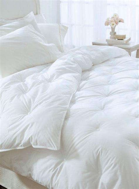 how to clean a comforter clean white down alternative tufted comforter from bedding com chic and simple bedroom