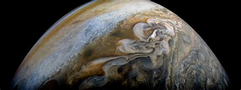 nasas juno captures jupiters ravaging northern storms