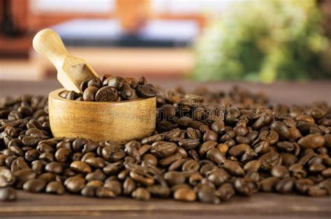 This remarkable blend of beans is the spirit of kicking horse coffee, and a. Dark Brown Coffee Beans Sweet Arabica On Grey Wood Stock Image - Image of fresh, arabian: 132291389