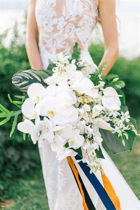 elegant tropical bouquet white orchids